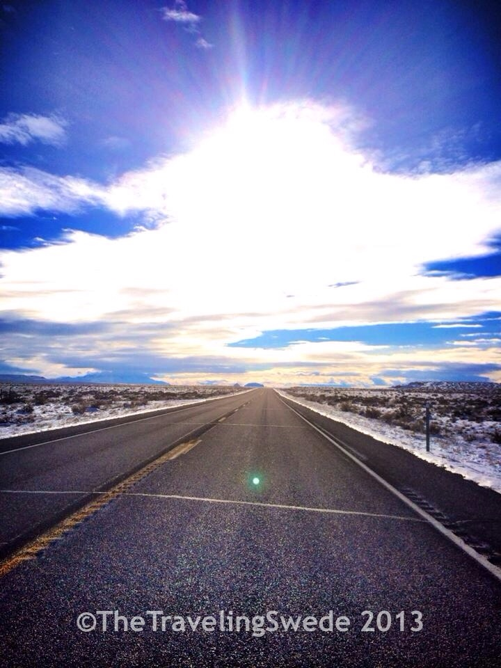 From snow to sun in matters of hours. En route to Goblin Valley.